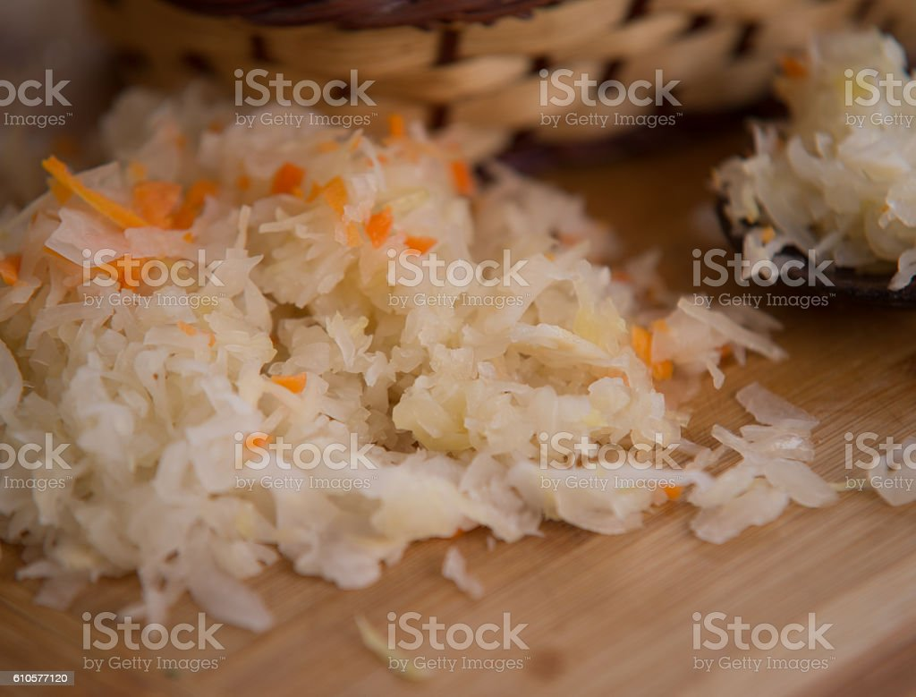 close up on Sauerkraut on wooden plate stock photo