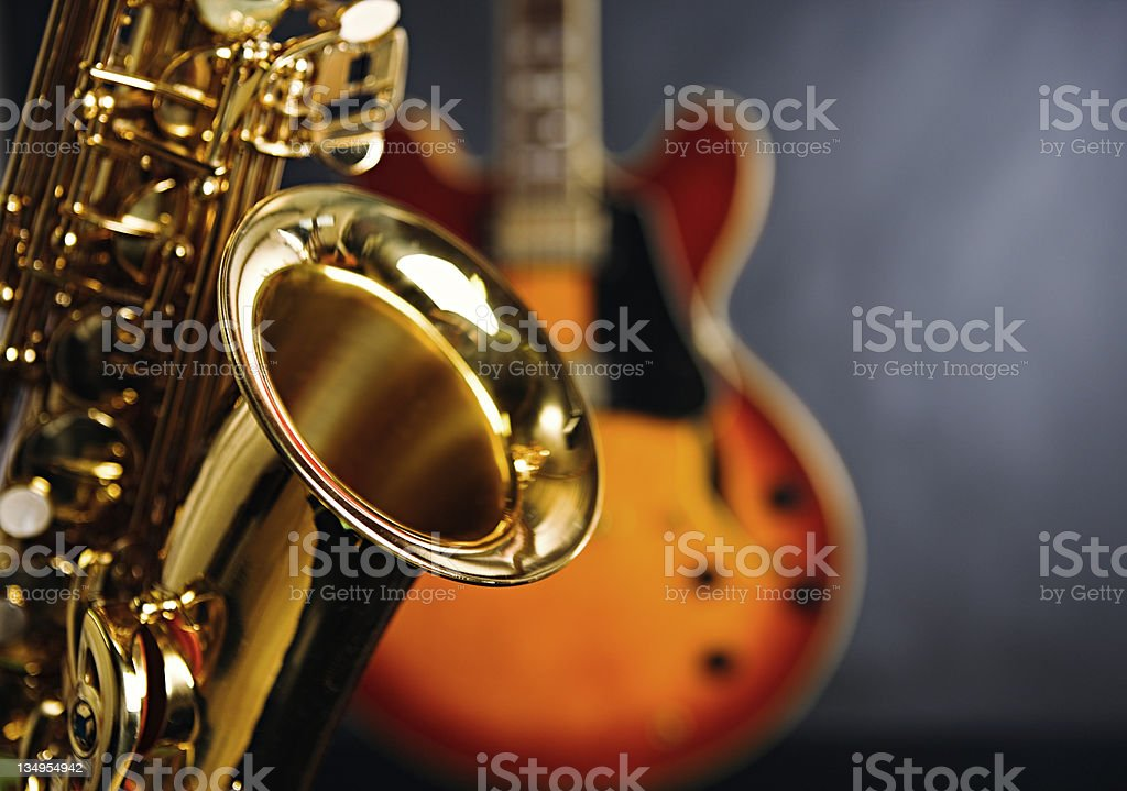 Close up on saxophone with guitar in background. Jazz rules! stock photo