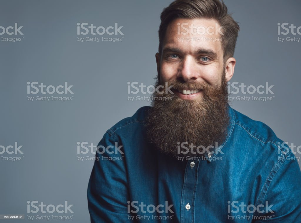 Close up on smiling male in denim shirt and beard stock photo