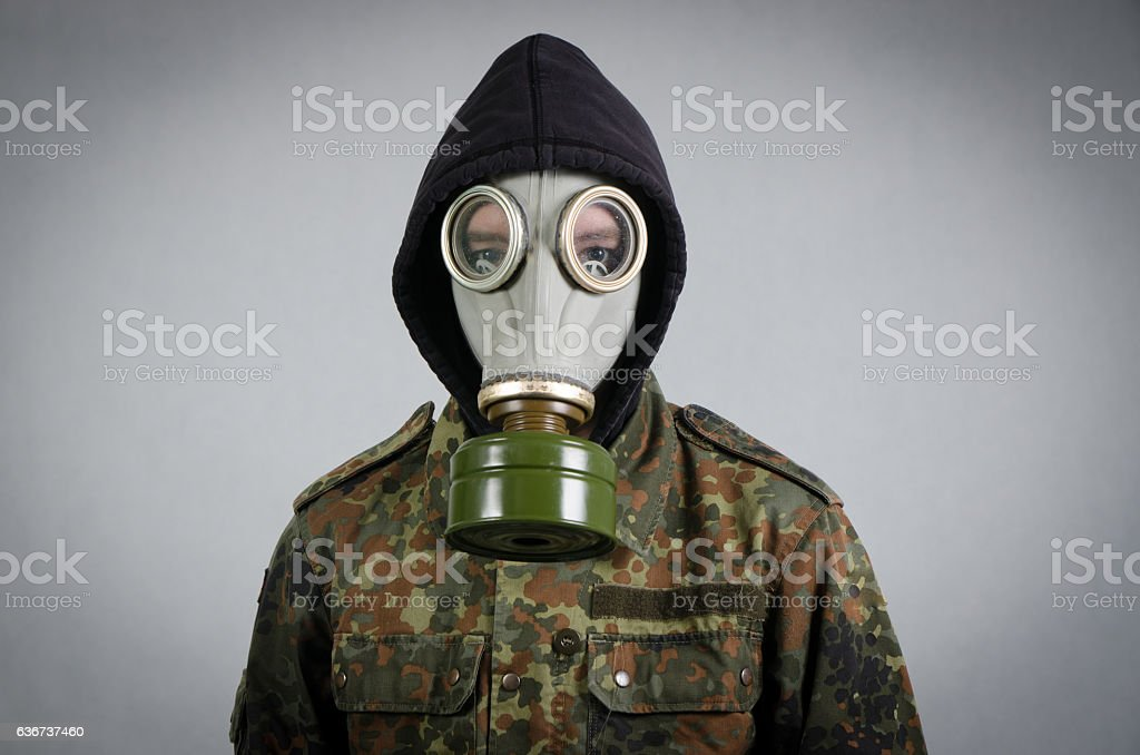 Close up on soldier wearing gas mask stock photo