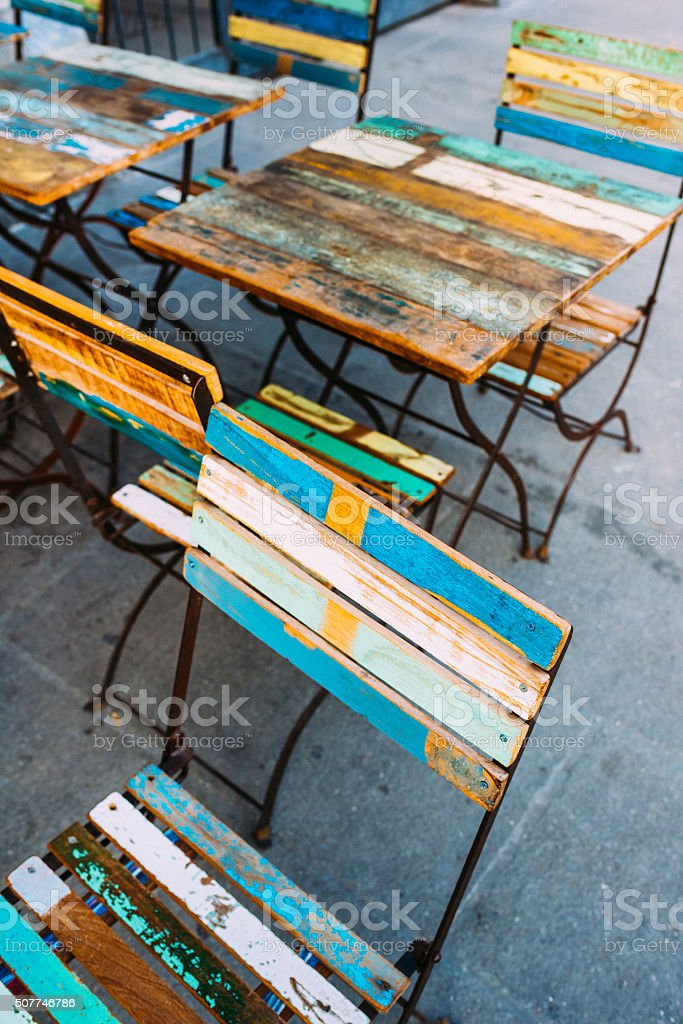 Close up on some colorful wooden chairs and table stock photo