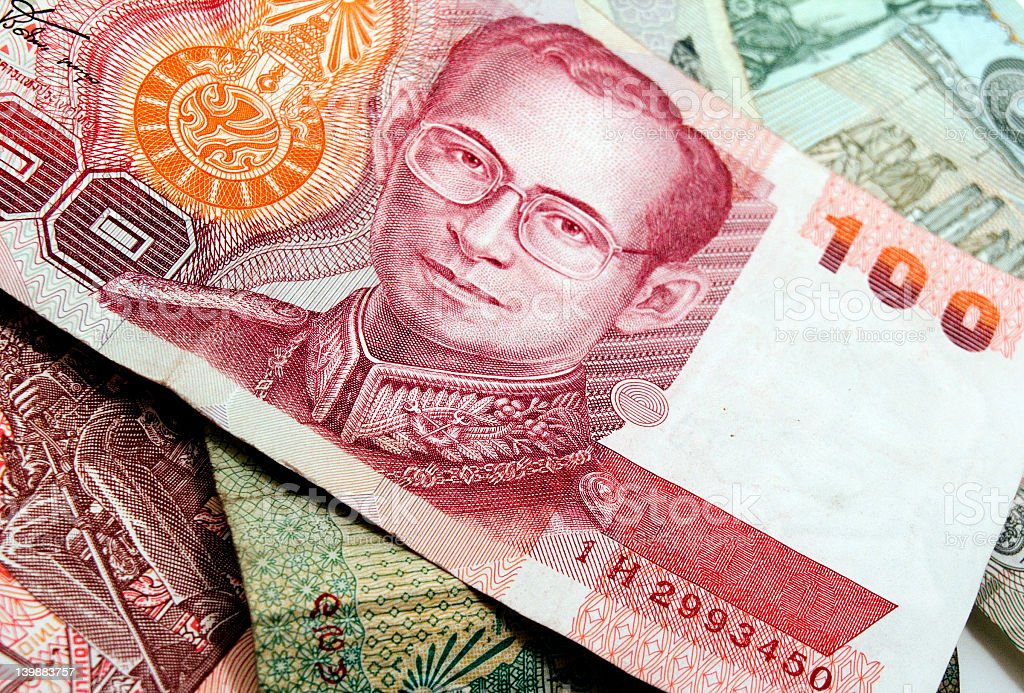 Close up on stacked Thai money paper bills royalty-free stock photo