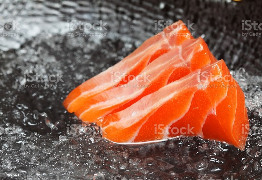 Close up on three slices of salmon sashimi stock photo