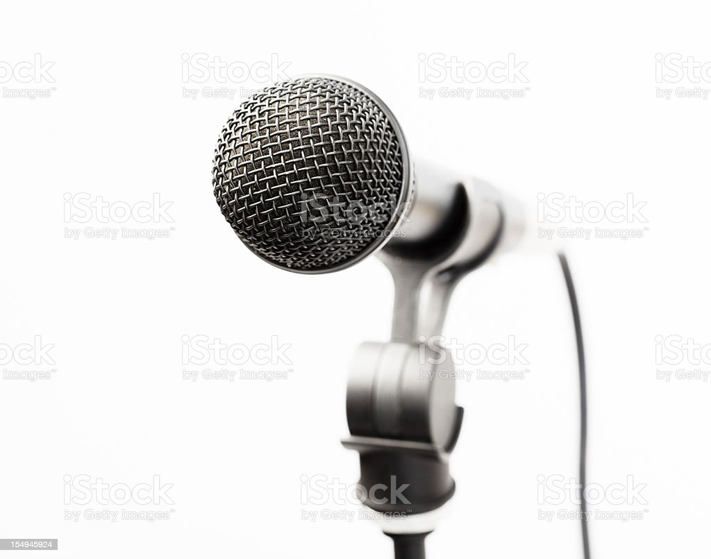 Close up on vocal microphone against white royalty-free stock photo