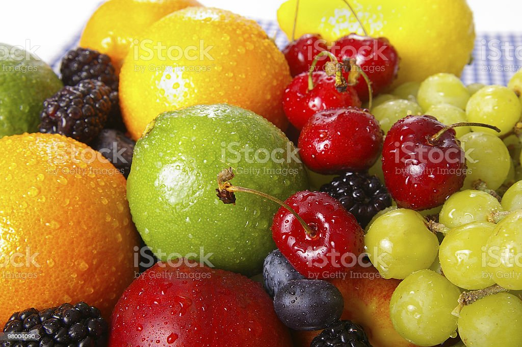 Close up on washed fresh colorful fruits on a table cloth royalty-free stock photo