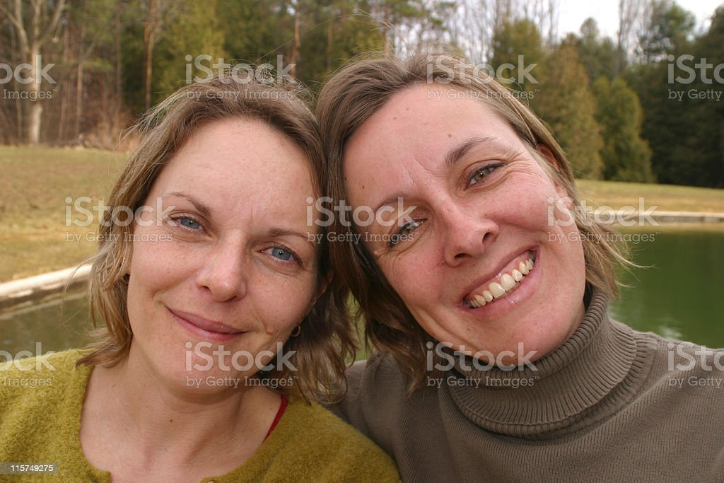 Close up outdoor portrait of two women smiling. royalty-free stock photo