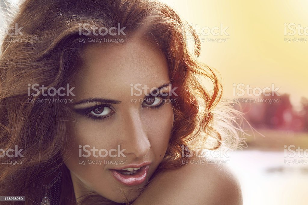 Close up outdoors portrait of red hair adult girl royalty-free stock photo