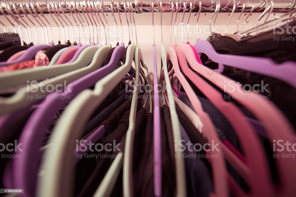 close up perspective cloths on hangers stock photo