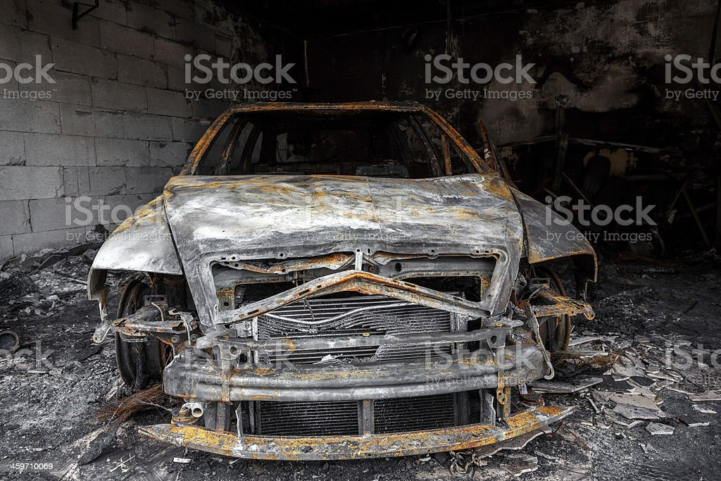 Close up photo of a burned out car stock photo