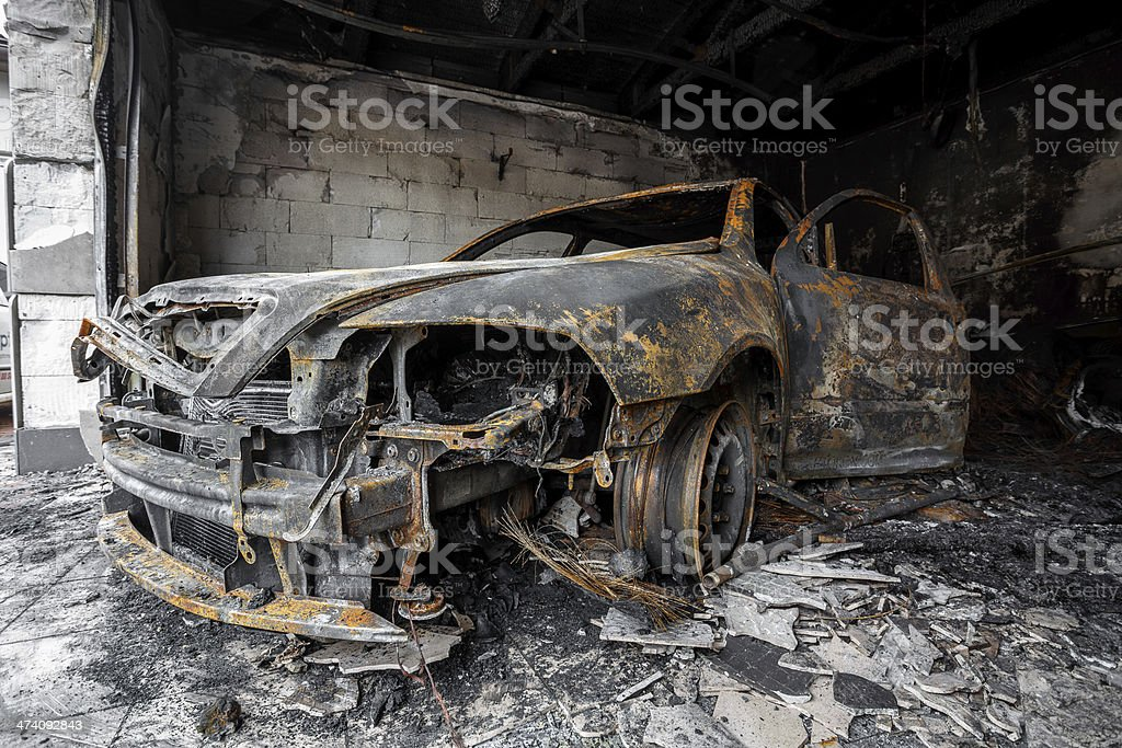 Close up photo of a burned out cars stock photo