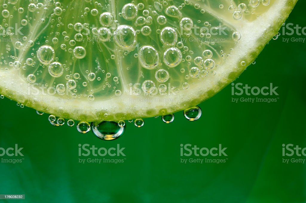 Close up photo of a lime with drops of moisture stock photo