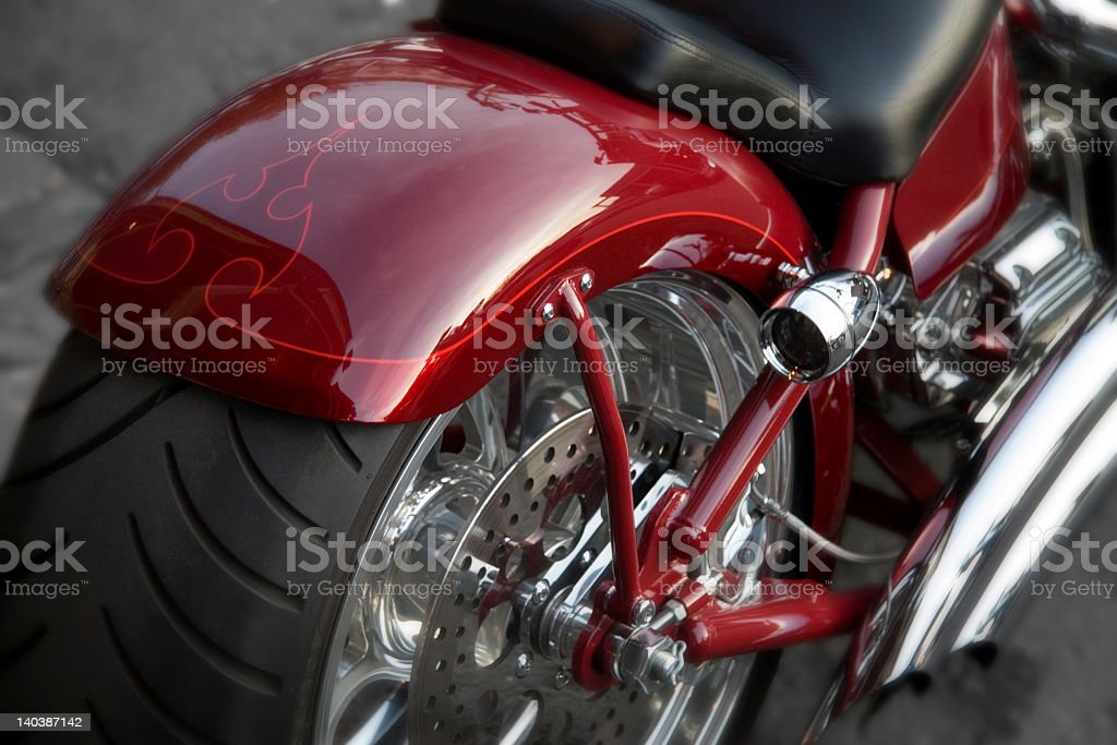 Close up photo of a rear motorcycle tire on a red chassis royalty-free stock photo