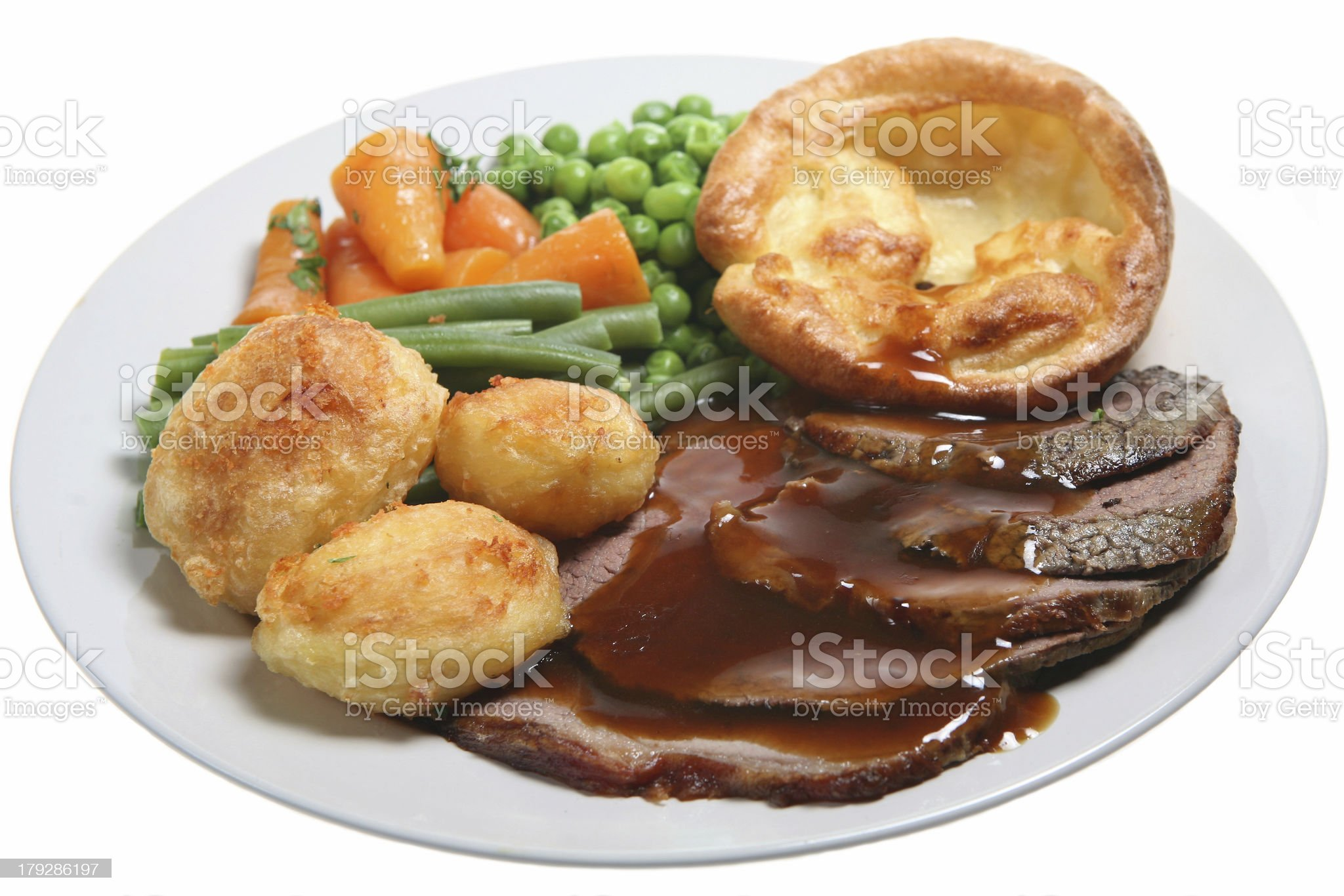 Close up photo of a roast beef, potatoes and veggies dinner royalty-free stock photo