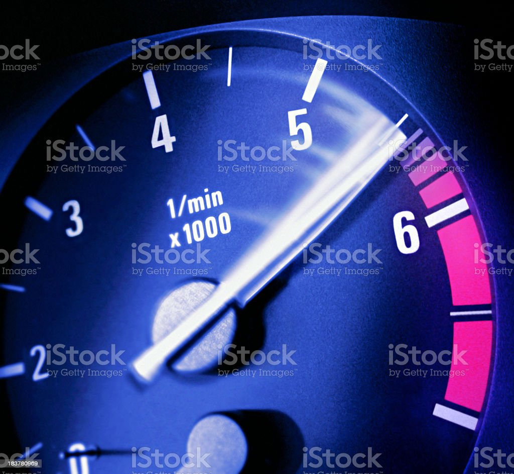 Close up photo of a tachometer  needle moving stock photo