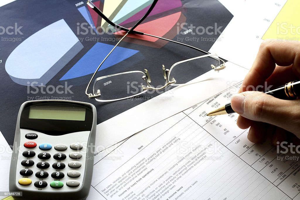 Close up photo of accounting work with pen and paper stock photo