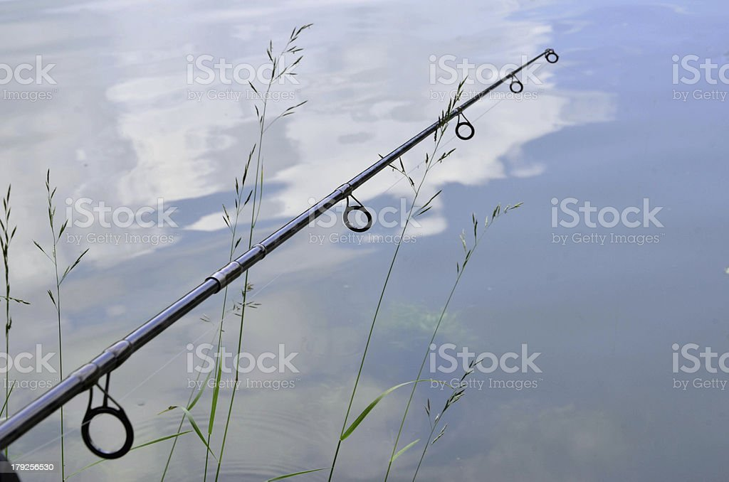 Close up photo of angling rod over the water royalty-free stock photo