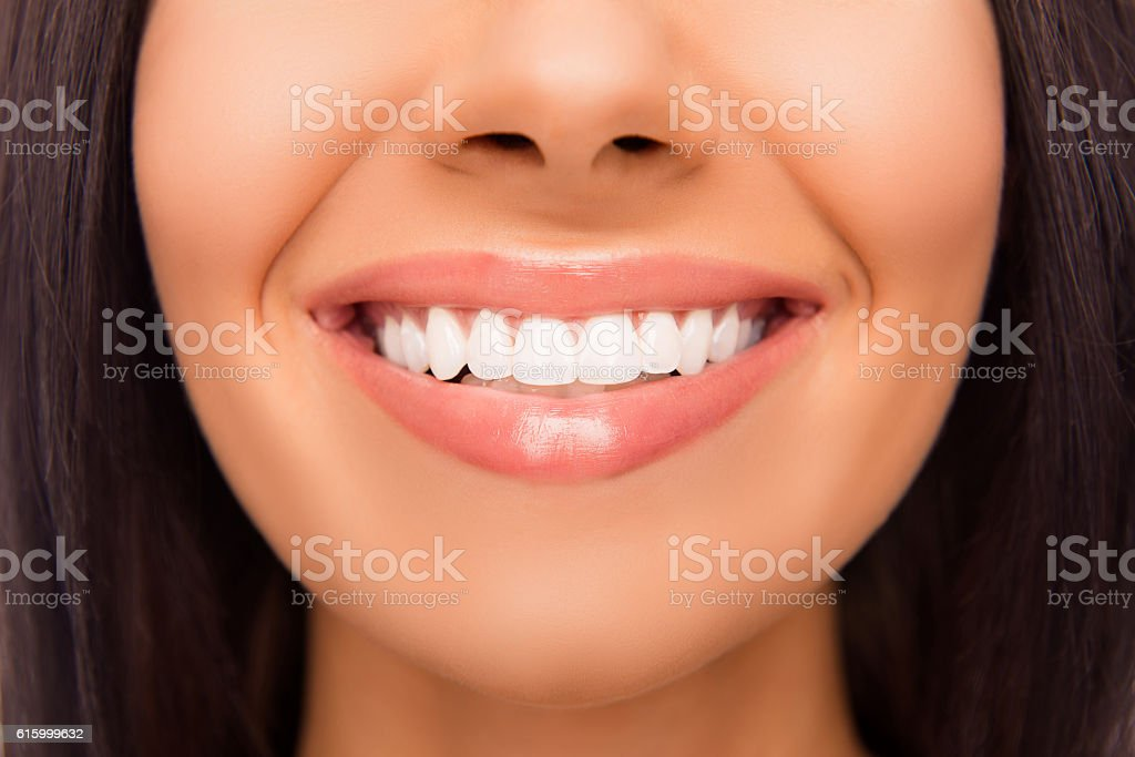 Close up photo of beaming woman's smile and healthy teeth stock photo