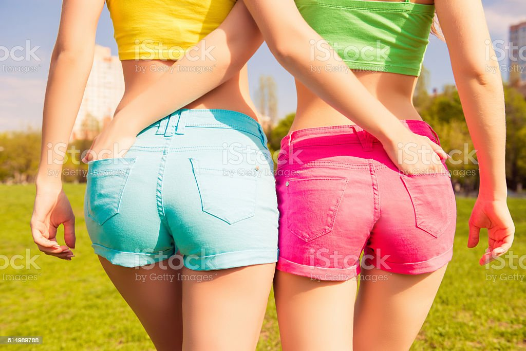 Close up photo of beautiful shapely woman in shorts stock photo