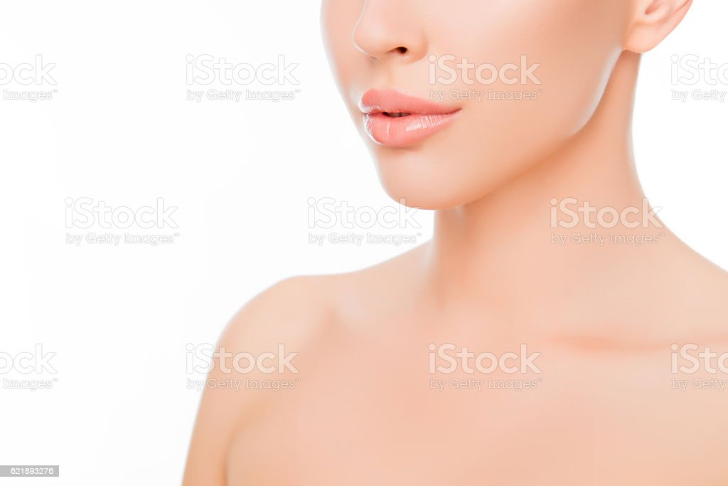 Close up photo of beautiful woman's lips and perfect skin stock photo