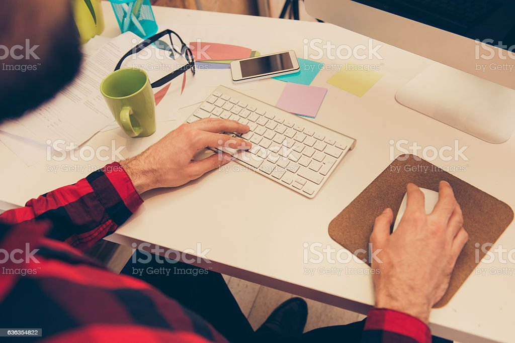 Close up photo of businessman working and typing on keyboard stock photo