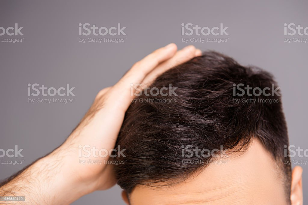 Close up photo of clean healthy man's hair without furfur stock photo