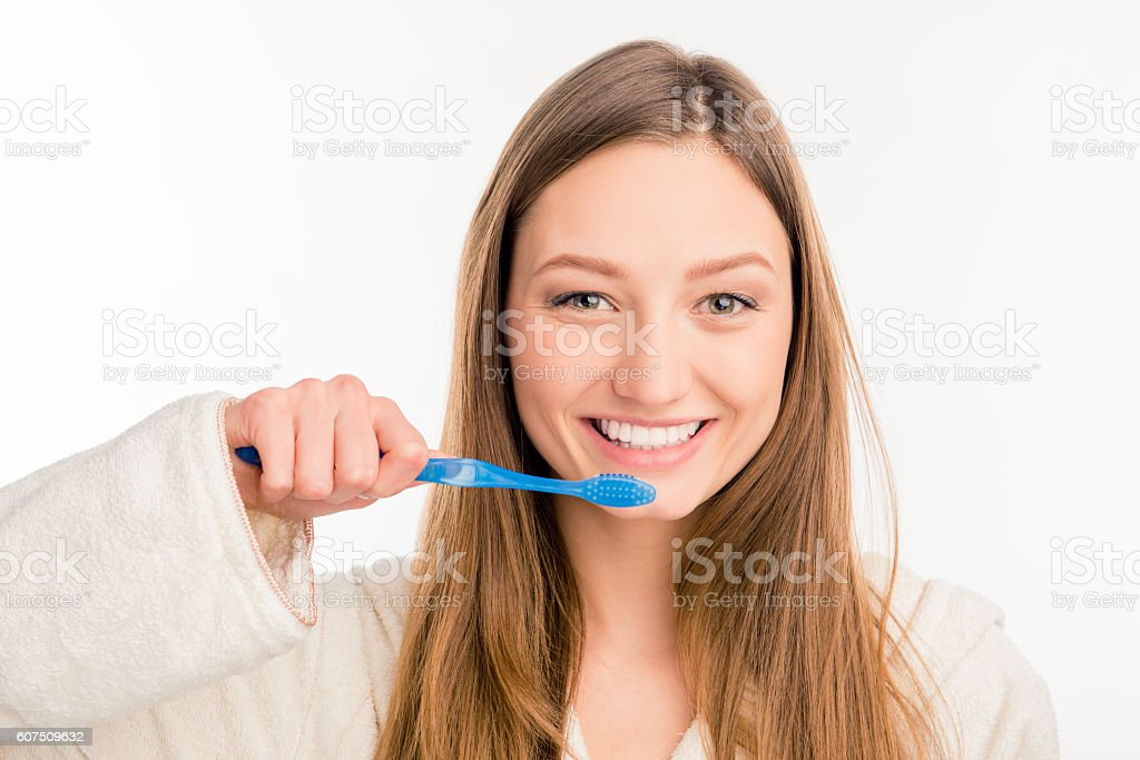 Close up photo of cute girl holding toothbrush stock photo