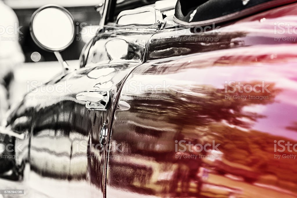 Close up photo of red veteran car, transition stock photo