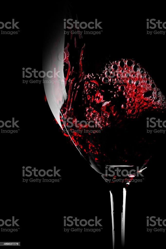 Close up photo of red wine isolated on a black background stock photo