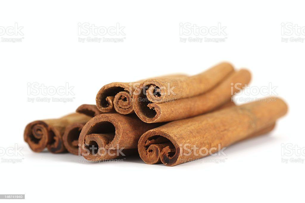 Close up photo of the ends of cinnamon sticks stock photo