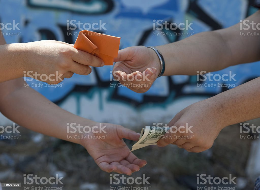Close Up Photo Of Two People Trading Drugs stock photo