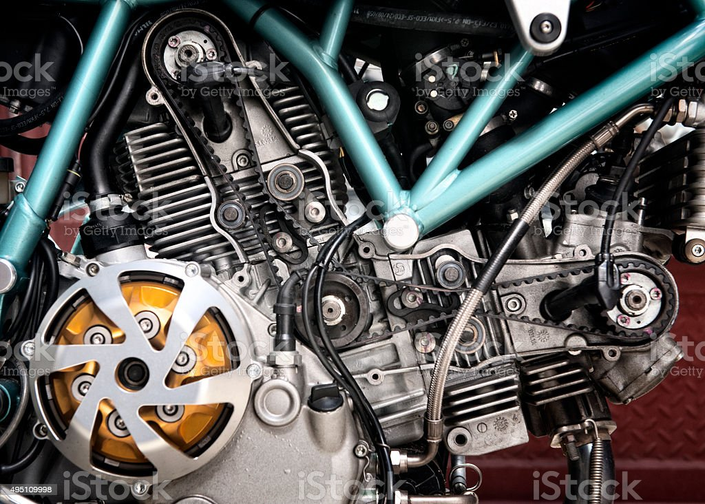 close up photograph of a naked V shape motorcycle engine stock photo