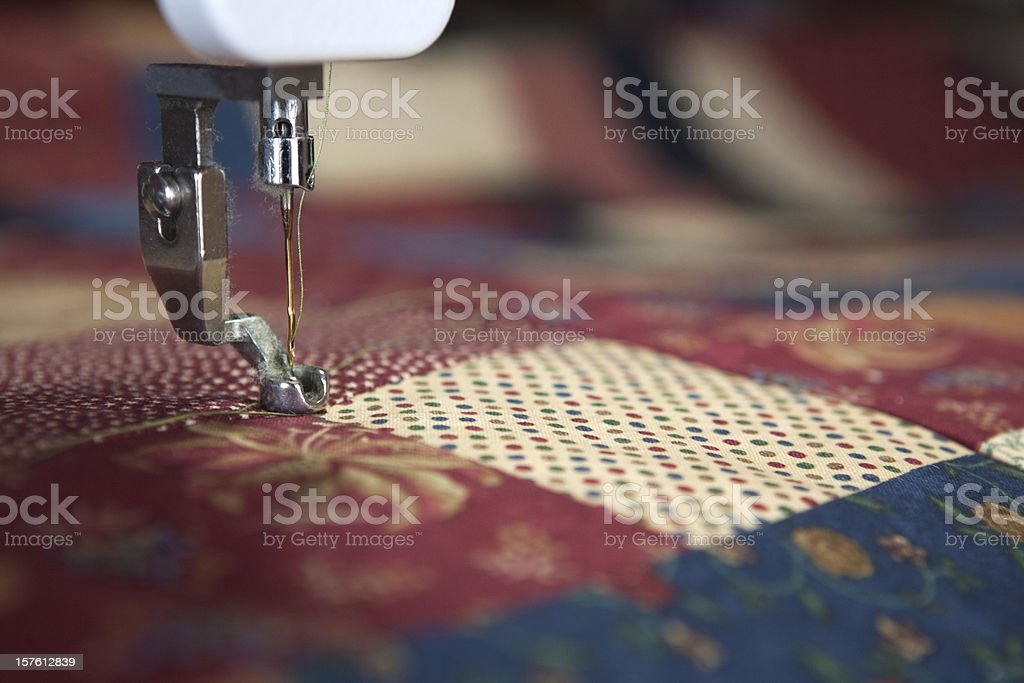 A close up photograph of a needle from a sewing machine royalty-free stock photo