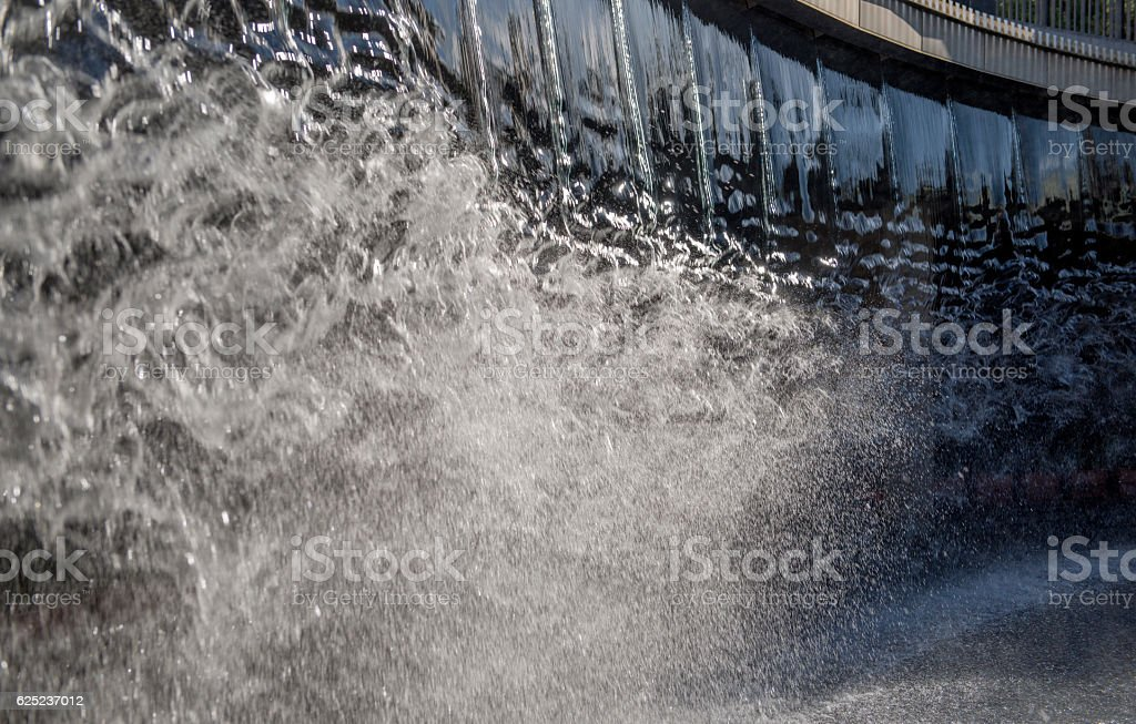 close up photograph of a small waterfall. stock photo