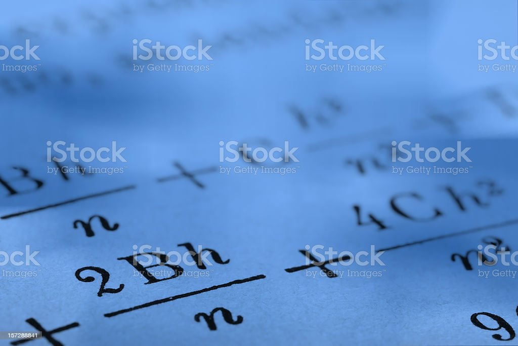 Close up photograph of mathematics on paper with blue tint royalty-free stock photo