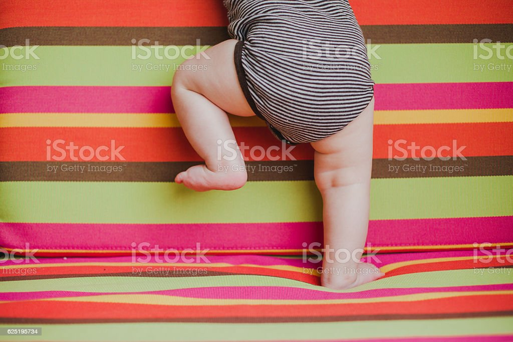 Close up picture of baby legs and feet stock photo