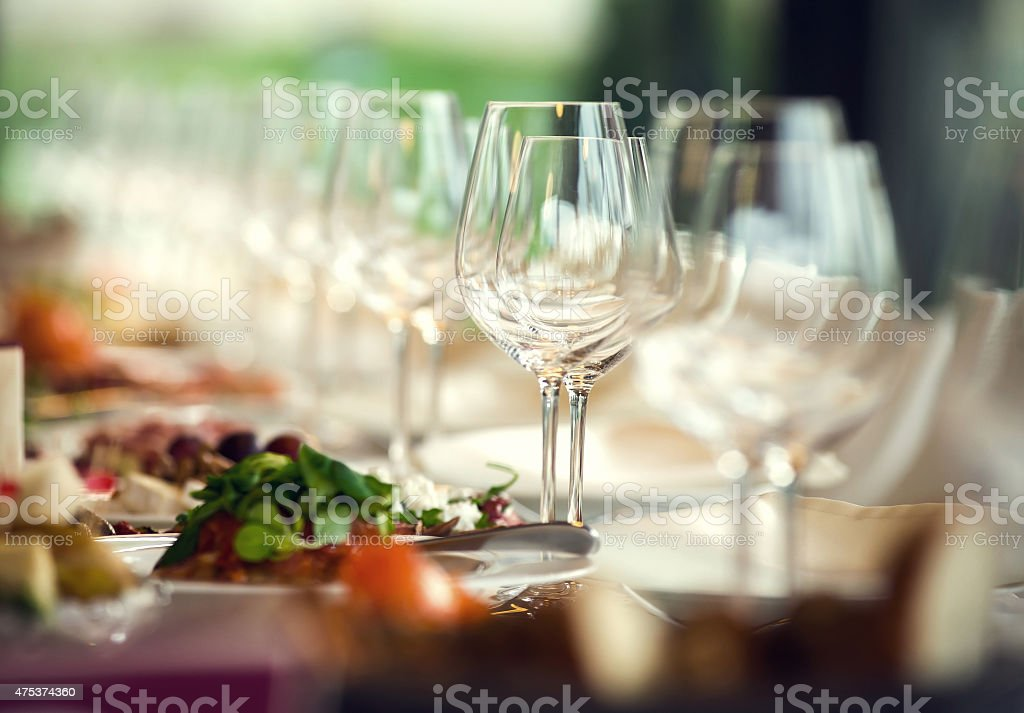 Close up picture of empty glasses in restaurant. Selective focus stock photo