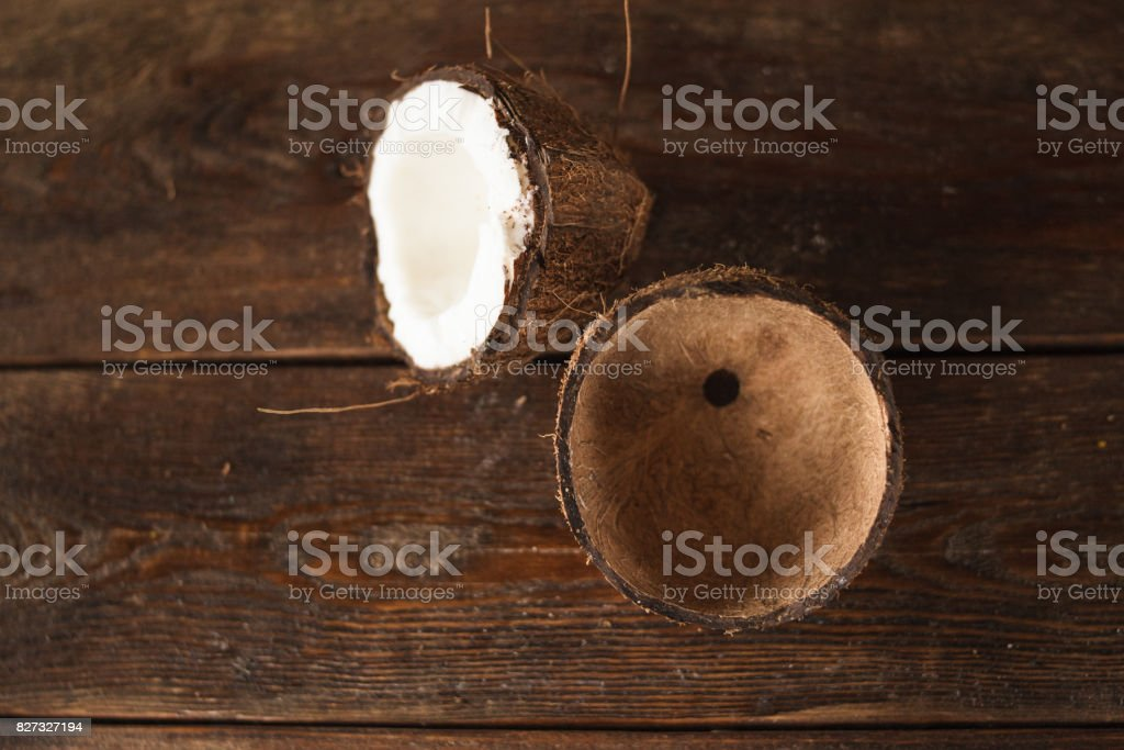 Close up pieces of coconut on wooden background stock photo