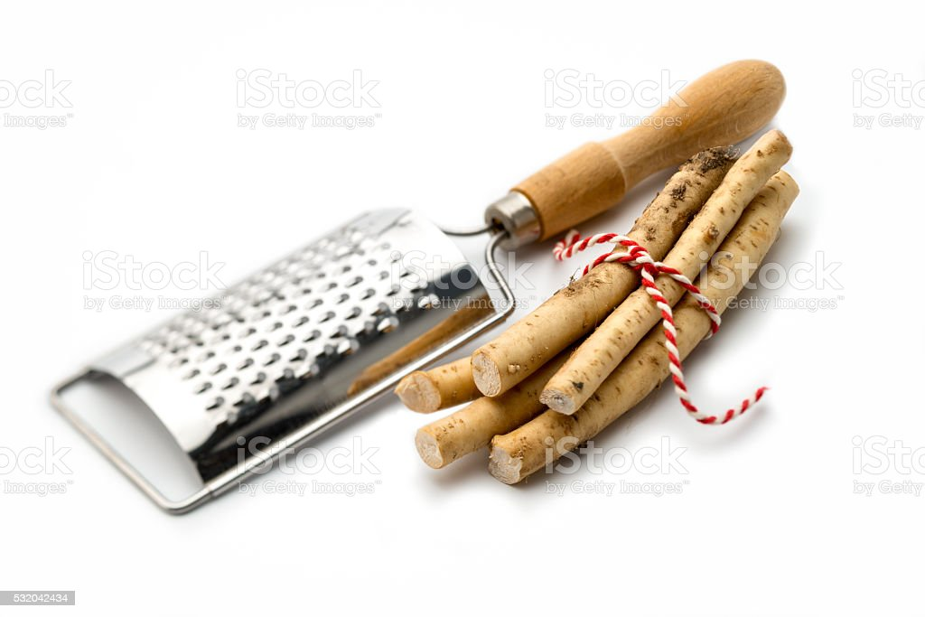 close up  pieces of horseradish on Food grater stock photo