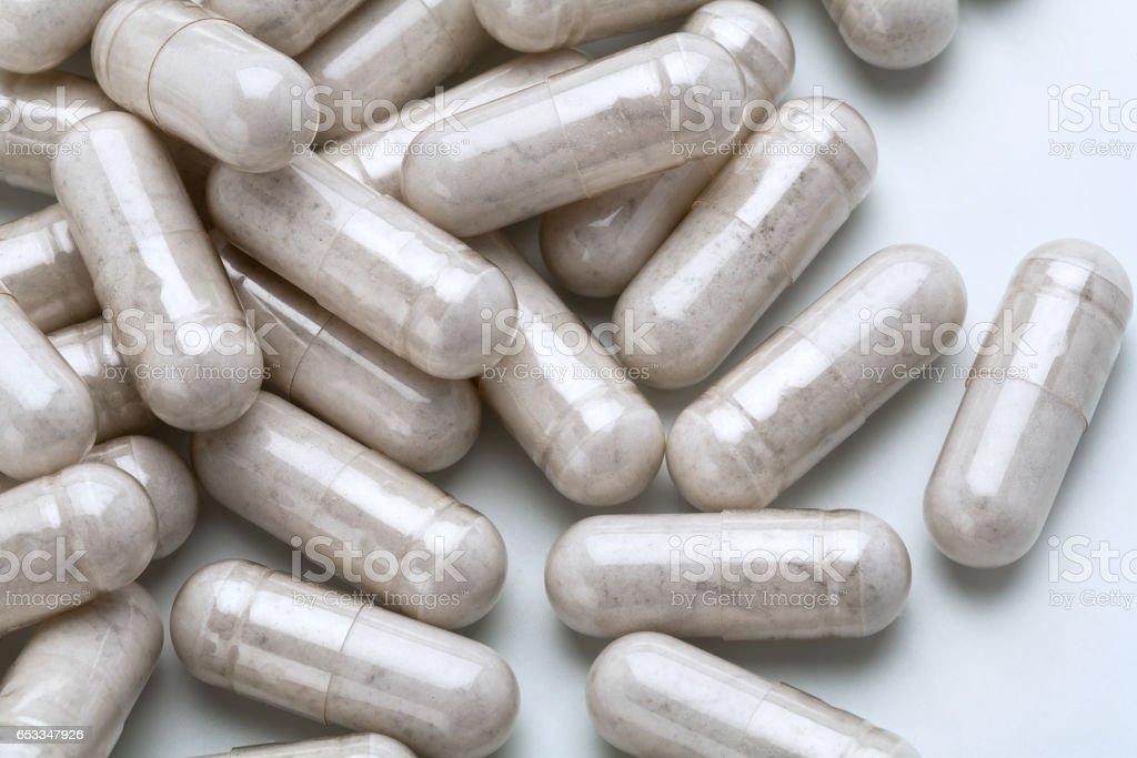 Close up pile of capsules probiotic powder inside. stock photo