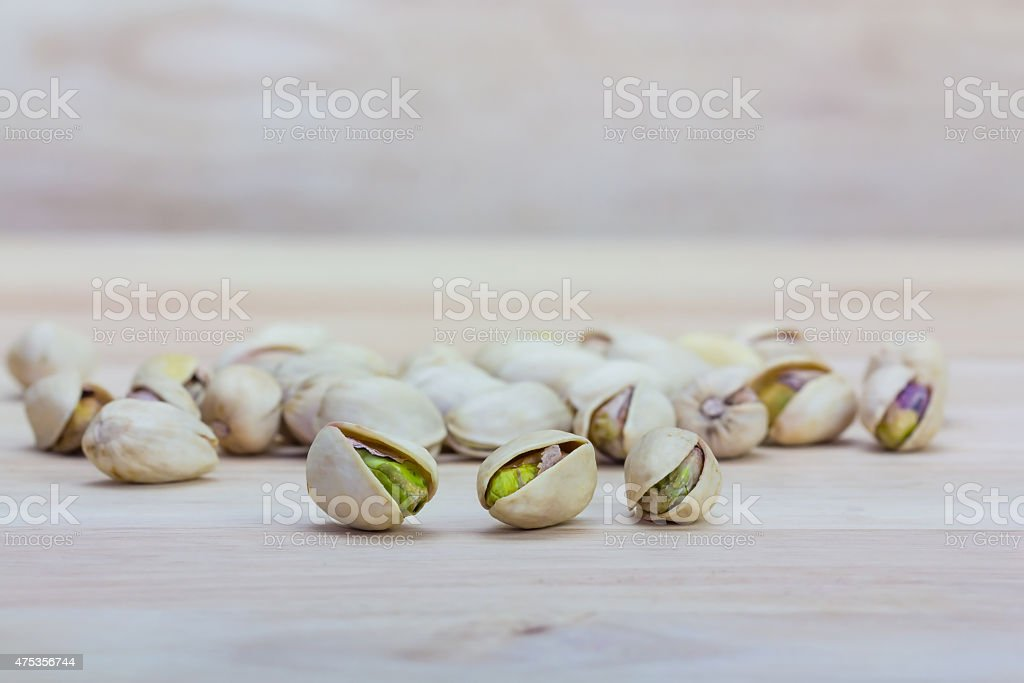 Close up pistachios on wooden background royalty-free stock photo