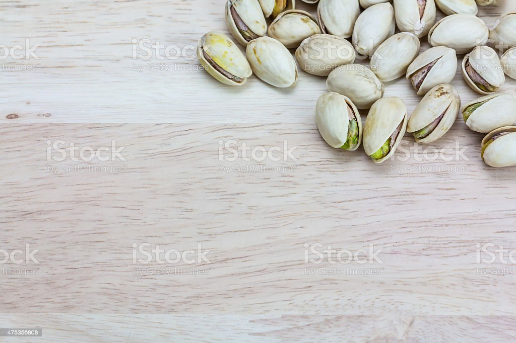 Close up pistachios on wooden background,Copy space royalty-free stock photo