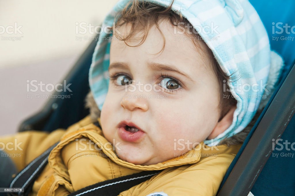 Close up portrait baby boy with big green eyes stock photo