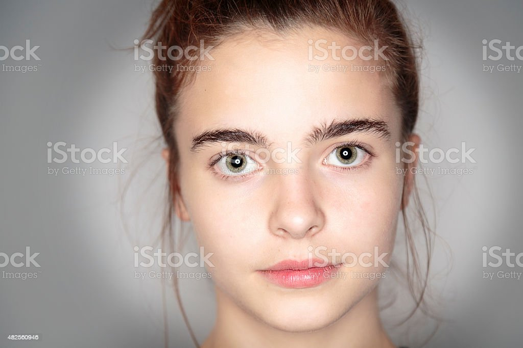 close up portrait of a beautiful young woman stock photo