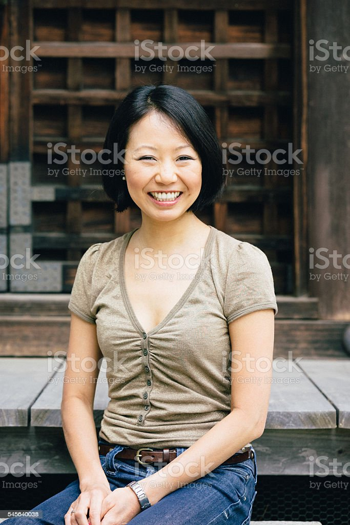 Close up portrait of a cheerful Japanese woman stock photo