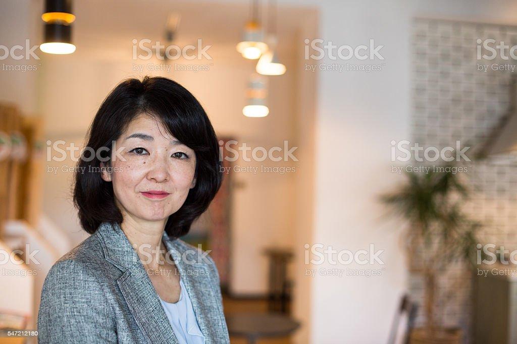 Close up portrait of a happy senior Japanese woman stock photo