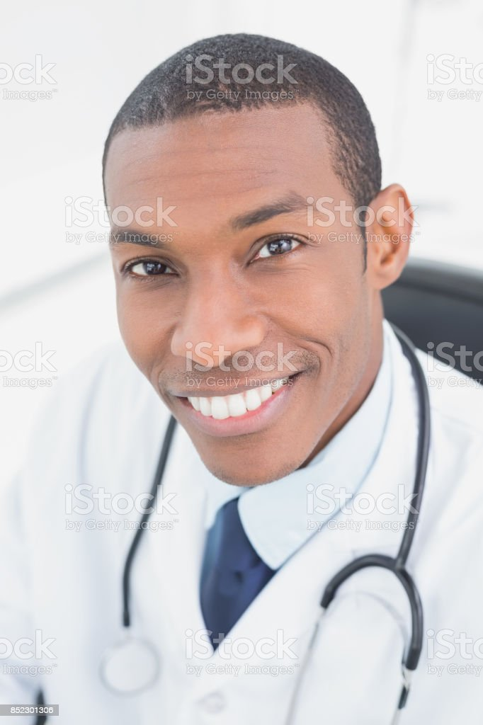 Close up portrait of a smiling male doctor stock photo