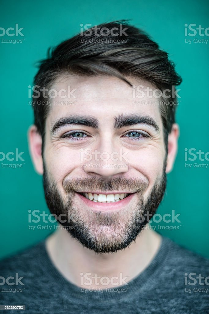 Close up portrait of a smiling young man with beard stock photo