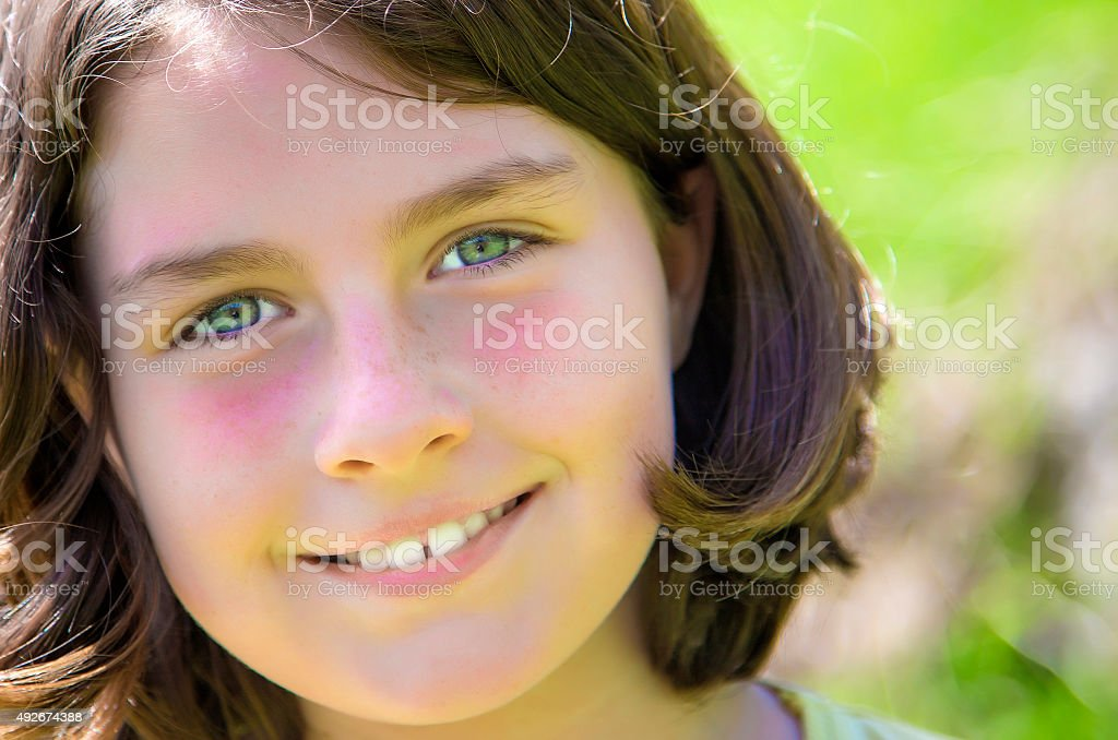 Close up portrait of a teenage girl smiling royalty-free stock photo