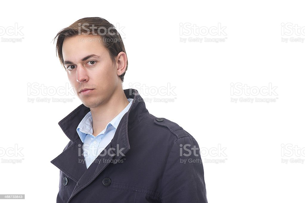 Close up portrait of a young man in blue jacket royalty-free stock photo
