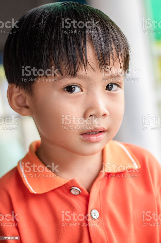 close up portrait of asian boy in blurred background stock photo